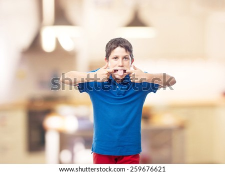 boy mocking in a kitchen - stock photo