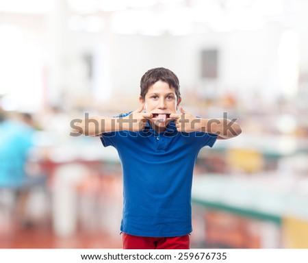 boy mocking in a school - stock photo