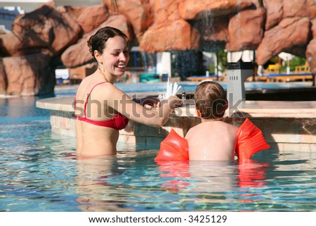 boy mother pool - stock photo