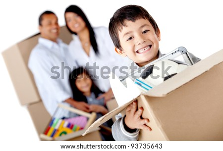 Boy moving with his family and holding a box with toys - isolated over a white background - stock photo