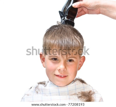 Boy mows clipper. Isolated on white background photo. - stock photo