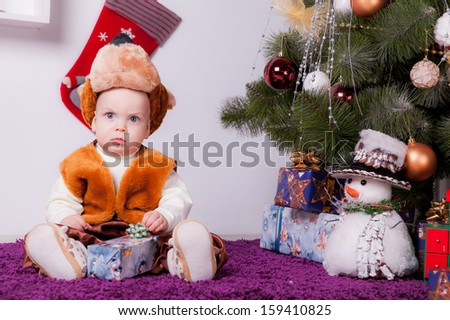 boy near a Christmas tree