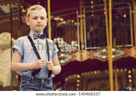 boy near game park attraction boy stock photo royalty free