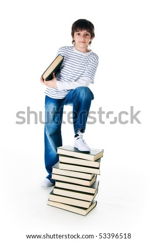 boy near the stack of big books on white background - stock photo