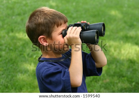 Boy Observing with Binoculars - stock photo