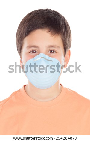 Boy of about twelve with allergy mask isolated on white background - stock photo