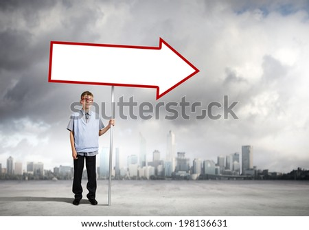 Boy of school age in glasses holding blank banner - stock photo