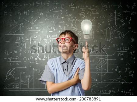 Boy of school age in glasses. Idea concept - stock photo