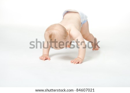 Boy of six month goes down on all fours - stock photo