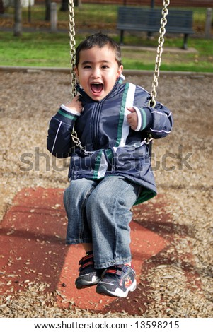 Boy on a swing - stock photo