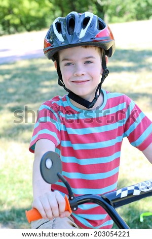 Boy on bicycle in the park