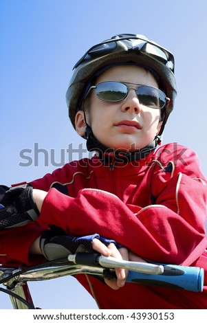 Boy on bicycle looks at end of the city - stock photo