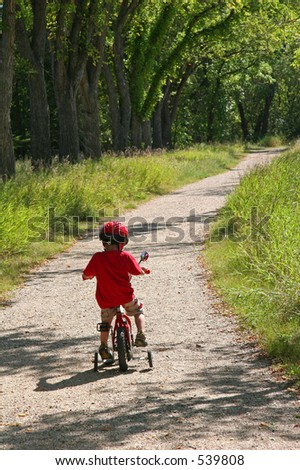Boy on Bike Path