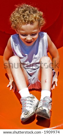 Boy on bottom of slide