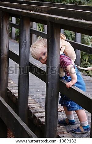 Boy on bridge - stock photo
