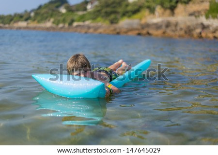 boy  on inflatable mattress - stock photo