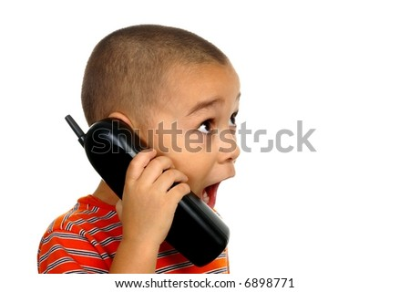 Boy on phone with shocked expression - stock photo