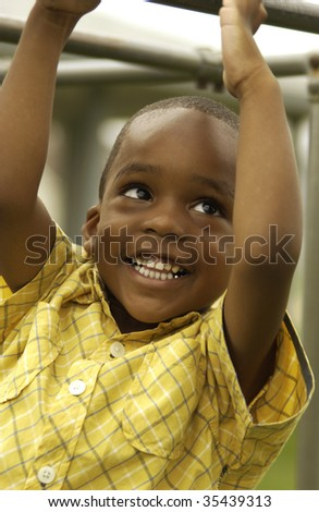 Boy on playground - stock photo