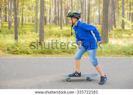 Boy  on skateboard skating  - stock photo