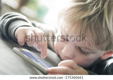 Boy on smartphone - stock photo