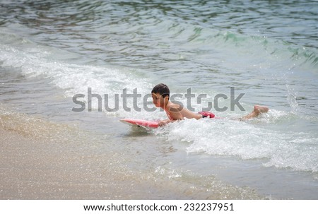 Boy on surf board - stock photo