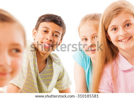 Boy on the back in focus with friends - stock photo
