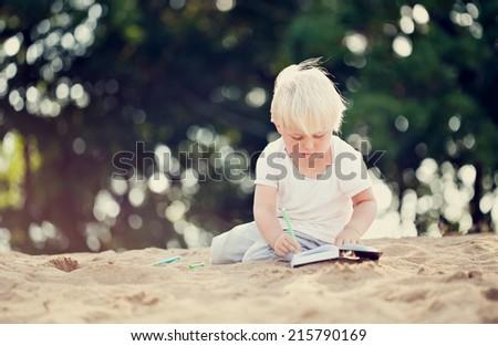 BOY ON THE BEACH - stock photo