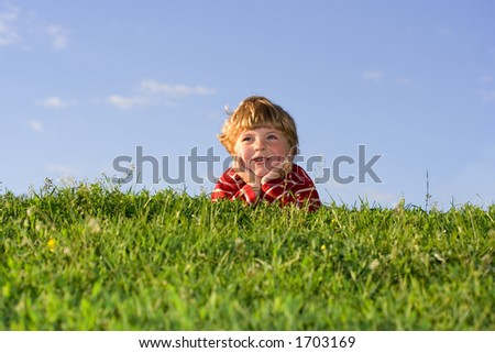 boy on the grass - stock photo
