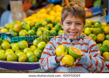 Boy on the market - stock photo