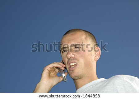 Boy on the phone,looking surprised