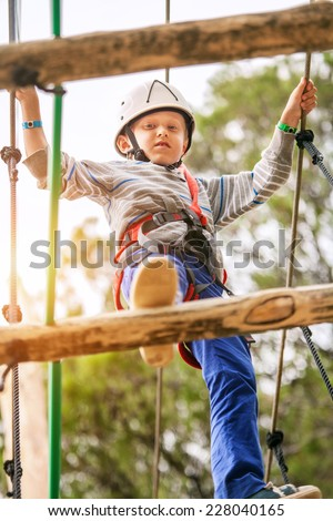 Boy on the rope track in adrenalin park