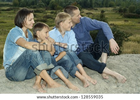 boy on the sand in the summer - stock photo