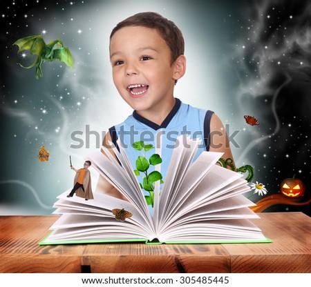 Boy opened a magic book - stock photo