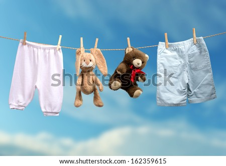 Boy or girl? on the outdoor clothesline - stock photo