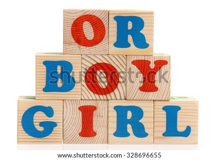 Boy or girl word formed by wood alphabet blocks on white background  - stock photo