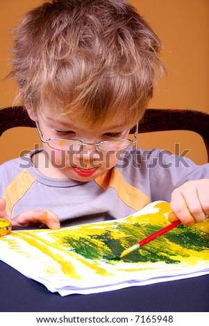 BOY PAINTING - stock photo