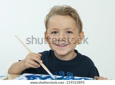 boy painting on white background - stock photo
