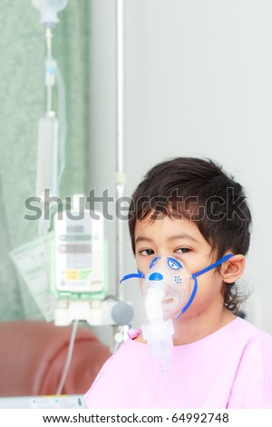 Boy patient in hospital and healing equipments - stock photo