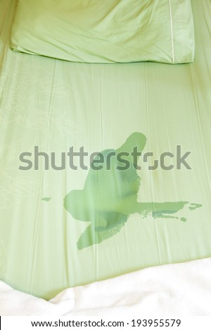 Boy pee on the bed - stock photo