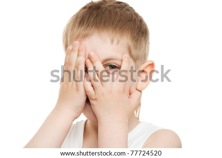 boy peeping out through fingers