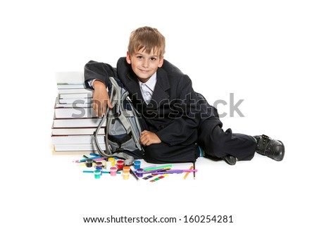 Boy, pencils, paints and books isolated on a white background