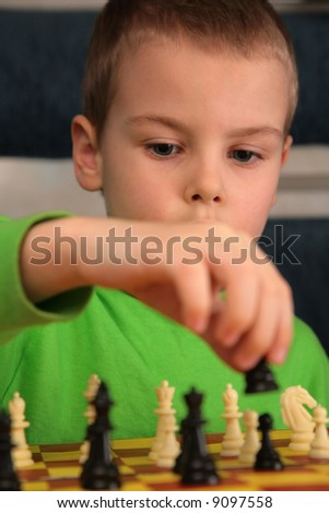 boy play chess - stock photo