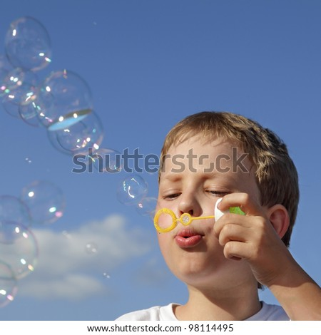 boy play in  bubbles - stock photo