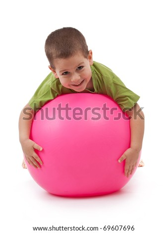 Boy play whit large ball isolated on white - stock photo