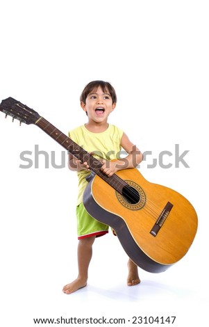 Boy playing a music with his guitar . - stock photo