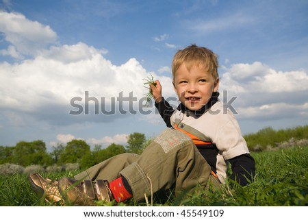 Boy playing at sunny day in park