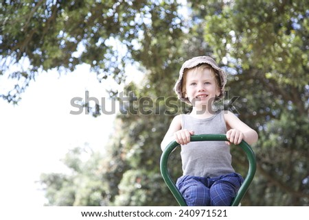 Boy playing at the park. - stock photo