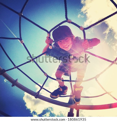 Boy playing at the park with instagram effect - stock photo