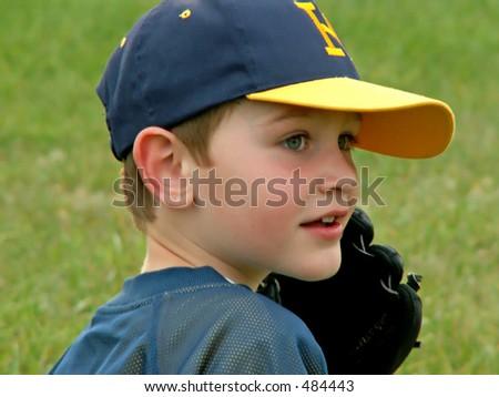boy playing baseball - soft focus - stock photo