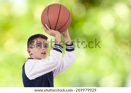boy playing basketball - stock photo